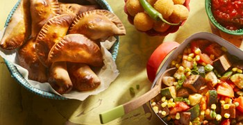 Argentinian empanadas filled with meat and olives, served with hot jalapeno balls